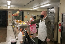 Dr Stair serves lunch at the Troy Junior Senior High Monday 9/14