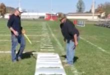 Maintenance team preparing football field